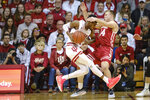Indiana guard Al Durham, left, drives into Wisconsin guard Brad Davison in the second half of an NCAA college basketball game in Bloomington, Ind., Saturday, March 7, 2020. Wisconsin won 60-56. (AP Photo/AJ Mast)