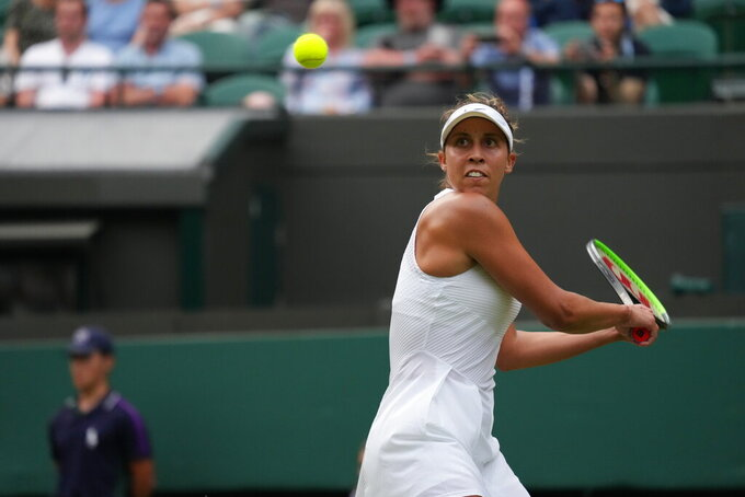 Madison Keys of the US plays a return to Belgium's Elise Mertens during the women's singles third round match on day five of the Wimbledon Tennis Championships in London, Friday July 2, 2021. (AP Photo/Alberto Pezzali)