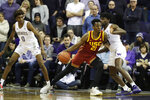 Southern California forward Onyeka Okongwu (21) drives against Washington forward Isaiah Stewart, right, as Washington forward Jaden McDaniels (0) looks on, during the first half of an NCAA college basketball game, Sunday, Jan. 5, 2020, in Seattle. (AP Photo/Ted S. Warren)