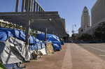 A homeless encampment is seen atop the Main St. overpass of the 101 freeway during the coronavirus outbreak, Thursday, May 21, 2020, in downtown Los Angeles. (AP Photo/Mark J. Terrill)