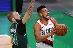 Portland Trail Blazers' CJ McCollum (3) shoots against Boston Celtics' Evan Fournier (94) during the first half of an NBA basketball game, Sunday, May 2, 2021, in Boston. (AP Photo/Michael Dwyer)