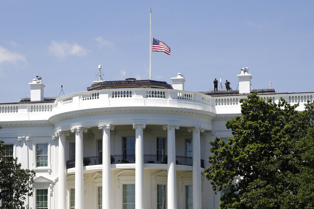 An American flag flies at half-staff over the White House in Washington, Saturday, July 18, 2020, in remembrance of Rep. John Lewis, D-Ga. Lewis, who carried the struggle against racial discrimination from Southern battlegrounds of the 1960s to the halls of Congress, died Friday. (AP Photo/Patrick Semansky)