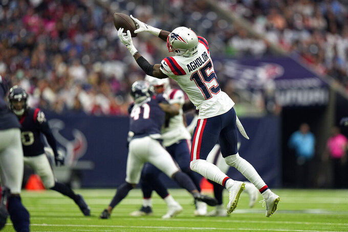 New England Patriots wide receiver Nelson Agholor (15) catches a pass against the Houston Texans during the second half of an NFL football game Sunday, Oct. 10, 2021, in Houston. (AP Photo/Eric Christian Smith)