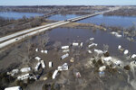 This Wednesday, March 20, 2019 aerial photo shows flooding near the Platte River in in Plattsmouth, Neb., south of Omaha. The National Weather Service is warning that flooding in parts of South Dakota and northern Iowa could soon reach historic levels. A Weather Service hydrologist says