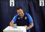 Italian Interior Minister and Deputy Premier Matteo Salvini, of the League, casts his ballot for the European Parliament elections, at a polling station in Milan, Italy, Sunday, May 26, 2019. Pivotal elections for the European Union parliament reach their climax Sunday as the last 21 nations go to the polls and results are announced in a vote that boils down to a continent-wide battle between euroskeptic populists and proponents of closer EU unity. (AP Photo/Antonio Calanni)