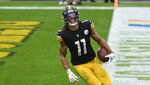Pittsburgh Steelers wide receiver Chase Claypool (11) scores his fourth touchdown of an NFL football game on a 35-yard pass play from quarterback Ben Roethlisberger during the second half in Pittsburgh, Sunday, Oct. 11, 2020. (AP Photo/Don Wright)