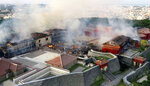 Smoke and flames rise from burning Shuri Castle in Naha, Okinawa, southern Japan, Thursday, Oct. 31, 2019. A fire spread among structures at Shuri Castle on Japan's southern island of Okinawa, nearly destroying the UNESCO World Heritage site. The burnt out main building of the castle is seen in the center. (Okinawa Times/Kyodo News via AP)
