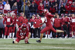 FILE - In this Nov. 16, 2019, file photo, Washington State kicker Blake Mazza (40) kicks a field goal that is held by punter Oscar Draguicevich III (94) during the second half of an NCAA college football game against Stanford, in Pullman, Wash. Mazza was selected to The Associated Press All-Pac 12 Conference team, Thursday, Dec. 12, 2019.  (AP Photo/Young Kwak, File)