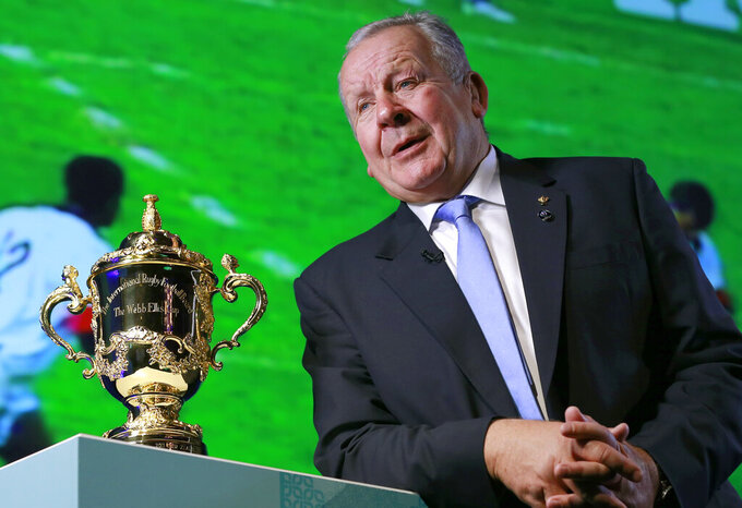 FILE - In this Thursday, Nov. 2, 2017 file photo, World Rugby Chairman Bill Beaumont speaks beside the Webb Ellis Cup during an interview before the match schedule announcement for the 2019 Rugby World Cup in Tokyo. Bill Beaumont and Agustin Pichot are vying to become chairman of World Rugby amid trying times for the sport because of the coronavirus outbreak and the growing discussion about a global calendar to unify the international game. (AP Photo/Shizuo Kambayashi, File)