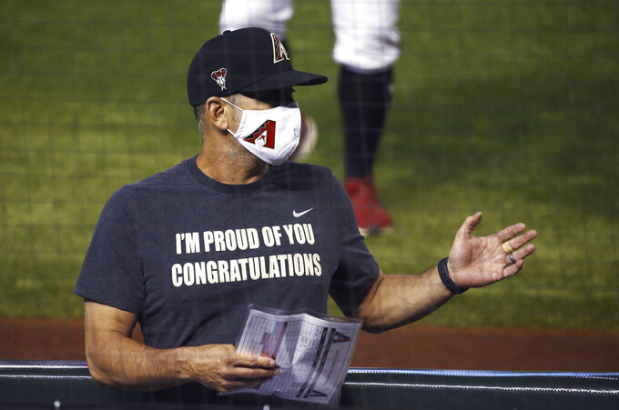 Arizona Diamondbacks manager Torey Lovullo gives instructions to players during an intrasquad baseball game Monday, July 6, 2020, in Phoenix. (AP Photo/Ross D. Franklin)