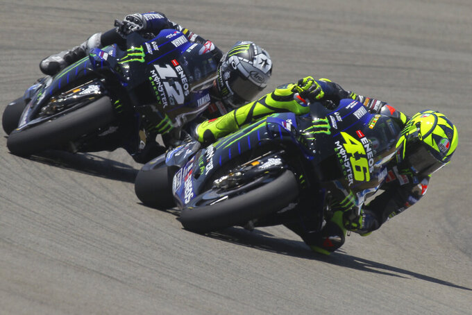 MotoGP Yamaha rider Valentino Rossi of Italy rides ahead of Yamaha rider Maverick Vinales of Spain during the Andalucia Motorcycle Grand Prix at the Angel Nieto racetrack in Jerez de la Frontera, Spain, Sunday July 26, 2020. Vinales finished 2nd with Rossi 3rd. (AP Photo/David Clares)