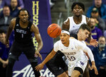 Washington guard Quade Green (55) eyes the ball on a rebound against Seattle during the first half of an NCAA college basketball game, Tuesday, Dec. 17, 2019, in Seattle. (Andy Bao/The Seattle Times via AP)