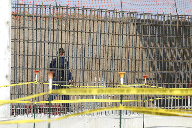 A McAllen K-9 police officer walks past rebar that will make up the border wall before DHS Acting Homeland Secretary Chad Wolf tours and speaks to the local media at the border wall under construction on Thursday, Nov. 21, 2019, south of Donna, Texas./The Monitor via AP)