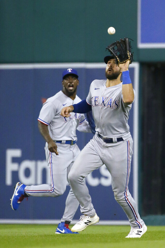 Texas Rangers right fielder Joey Gallo catches a fly ball hit by Detroit Tigers' Akil Baddoo, with center fielder Adolis Garcia, left, backing up the play during the fifth inning of a baseball game Tuesday, July 20, 2021, in Detroit. (AP Photo/Duane Burleson)