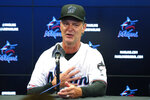 Miami Marlins manager Don Mattingly gestures as he speaks, Friday, Sept. 20, 2019, during a news conference in Miami. Mattingly will be back with the Marlins in 2020. His contract extension announced Friday is for two years, plus a mutual option for a third year in 2022. (AP Photo/Wilfredo Lee)