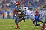 Florida Atlantic wide receiver Willie Wright (1) tries to elude the tackle of Louisiana Tech safety Darryl Lewis (38)during an NCAA college game in Boca Raton, Fla., Friday, Oct. 26, 2018. (Jim Rassol/South Florida Sun-Sentinel via AP)