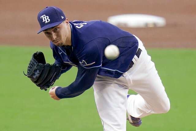 Tampa Bay Rays pitcher Blake Snell (4) delivers against New York Yankees' DJ LeMahieu during the first inning in Game one of a baseball American League Division Series Monday, Oct. 5, 2020, in San Diego. (AP Photo/Jae C. Hong)