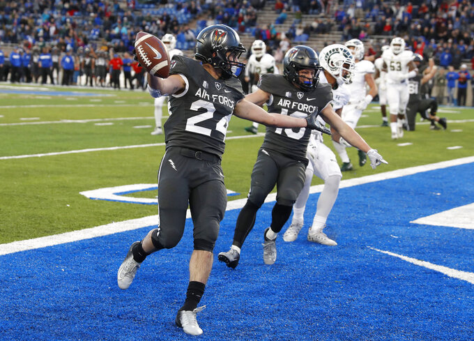 Air Force running back Kadin Remsberg, left, celebrates his touchdown with wide receiver Andrew Smith in the second half of an NCAA college football game against Colorado State Thursday, Nov. 22, 2018, at Air Force Academy, Colo.(AP Photo/David Zalubowski)