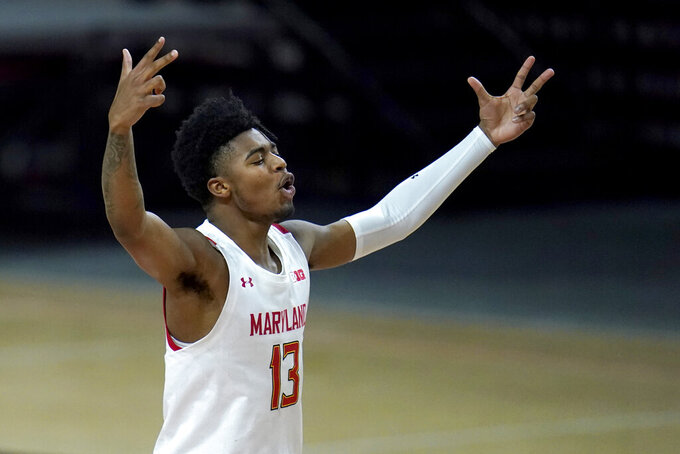 Maryland guard Hakim Hart reacts after a shot against Nebraska during the second half of an NCAA college basketball game, Wednesday, Feb. 17, 2021, in College Park, Md. (AP Photo/Julio Cortez)