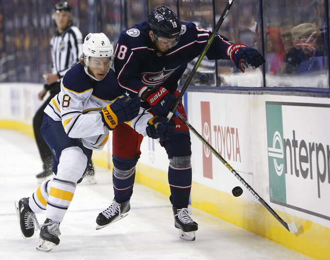 Buffalo Sabres' Casey Nelson, left, and Columbus Blue Jackets' Pierre-Luc Dubois chase a loose puck during the second period of an NHL hockey game Saturday, Oct. 27, 2018, in Columbus, Ohio. (AP Photo/Jay LaPrete)