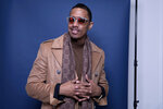 FILE - In this Dec. 10, 2018, photo, Nick Cannon poses for a portrait in New York to promote promoting his new show,