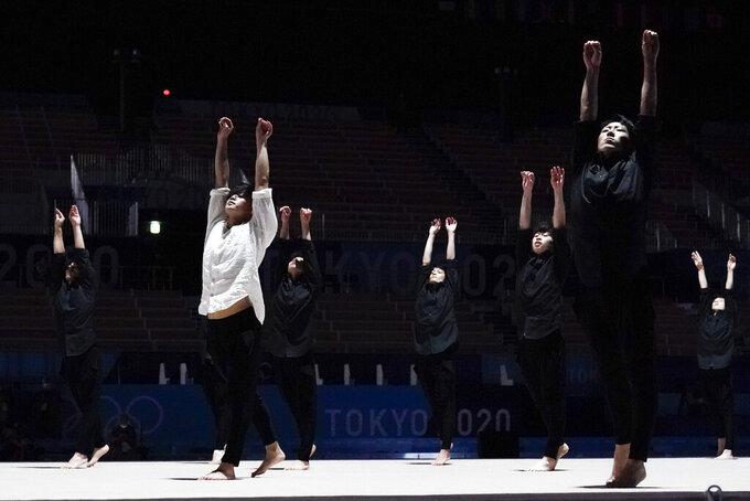 Male rhythmic gymnasts perform before the women's rhythmic gymnastics individual all-around final at the 2020 Summer Olympics, Saturday, Aug. 7, 2021, in Tokyo, Japan. (AP Photo/Ashley Landis)