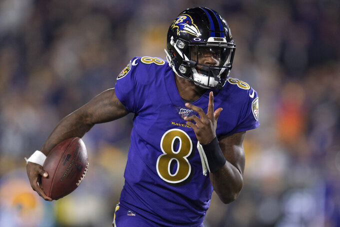 Baltimore Ravens quarterback Lamar Jackson runs against the Los Angeles Rams during the first half of an NFL football game Monday, Nov. 25, 2019, in Los Angeles. (AP Photo/Kyusung Gong)
