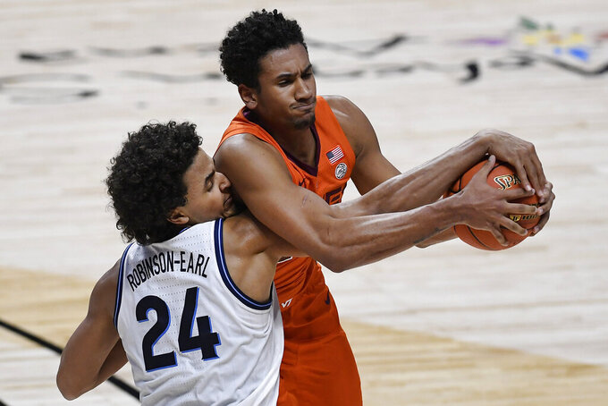 Villanova's Jeremiah Robinson-Earl, left, and Virginia Tech's Keve Aluma compete for possession of the ball during the second half of an NCAA college basketball game Saturday, Nov. 28, 2020, in Uncasville, Conn. (AP Photo/Jessica Hill)