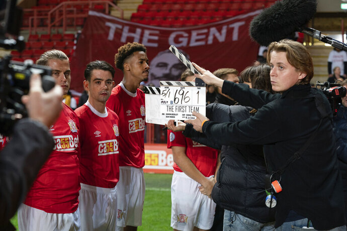"""This undated photo made available by Terry Cartwright Television Ltd shows the filming in London of """"The First Team"""" a new BBC comedy drama series about a fictional soccer team. One of the executive producers is Tom Werner, the American chairman of Liverpool, who was a source of behind-the-scenes knowledge and footballing contacts. (Terry Cartwright Television Ltd via AP)"""