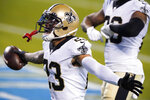 New Orleans Saints cornerback Marshon Lattimore celebrates after an interception during the second half of an NFL football game against the Carolina Panthers Sunday, Jan. 3, 2021, in Charlotte, N.C. (AP Photo/Brian Blanco)