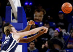 Butler center Joey Brunk, front, and DePaul forward Femi Olujobi battle for a loose ball during the first half of an NCAA college basketball game Wednesday, Jan. 16, 2019, in Chicago. (AP Photo/Nam Y. Huh)