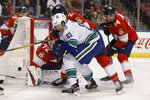 Vancouver Canucks center Jay Beagle (83) fights to score during an NHL hockey game against the Florida Panthers, Thursday, Jan. 9, 2020, in Sunrise, Fla. (AP Photo/Brynn Anderson)