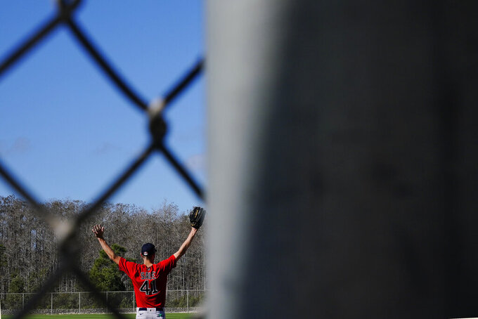 Boston Red Sox pitcher Chris Sale stretches before he runs onto the field to workout during spring training baseball practice on Monday, Feb. 22, 2021, in Fort Myers, Fla. (AP Photo/Brynn Anderson)