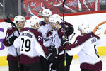 Colorado Avalanche right wing Mikko Rantanen (96), of Finland, celebrates his goal with center Nathan MacKinnon (29), left wing Gabriel Landeskog (92), of Sweden, defenseman Samuel Girard (49), and defenseman Erik Johnson (6) during the third period of an NHL hockey game against the Washington Capitals, Thursday, Feb. 7, 2019, in Washington. (AP Photo/Nick Wass)