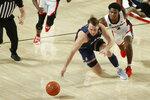 Samford's Logan Dye, left, and Georgia's Sahvir Wheeler (2) compete for the ball during an NCAA college basketball game in Athens, Ga., Saturday, Dec. 12, 2020. (Joshua L. Jones/Athens Banner-Herald via AP)