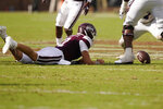 Mississippi State quarterback Will Rogers (2) reaches for the ball after having it stripped from his hands by a Louisiana Tech defensive player during the first half of an NCAA college football game in Starkville, Miss., Saturday, Sept. 4, 2021. (AP Photo/Rogelio V. Solis)