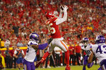 Kansas City Chiefs wide receiver Marcus Kemp (85) catches a touchdown pass as Minnesota Vikings safety Myles Dorn, left, defends during the first half of an NFL football game Friday, Aug. 27, 2021, in Kansas City, Mo. (AP Photo/Charlie Riedel)
