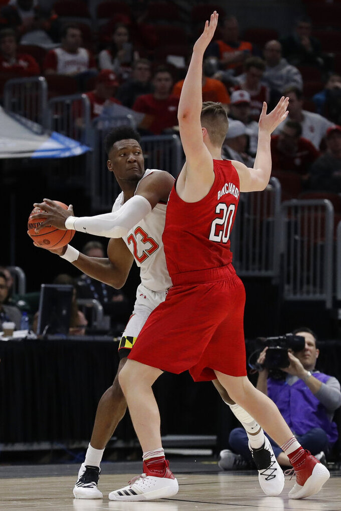 Maryland's Bruno Fernando (23) looks to pass the ball against Nebraska's Tanner Borchardt (20) during the first half of an NCAA college basketball game in the second round of the Big Ten Conference tournament, Thursday, March 14, 2019, in Chicago. (AP Photo/Nam Y. Huh)