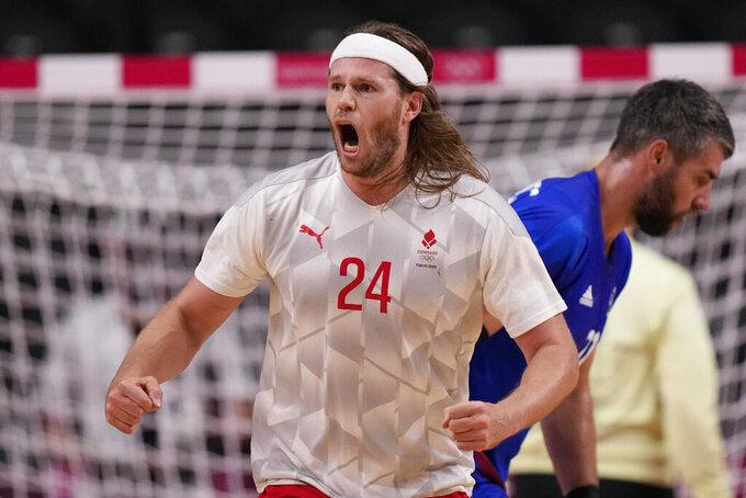 Denmark's Mikkel Hansen celebrates during the men's gold medal handball match between France and Denmark at the 2020 Summer Olympics, Saturday, Aug. 7, 2021, in Tokyo, Japan. (AP Photo/Pavel Golovkin)