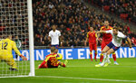 England's Harry Kane, right, scores the fifth goal during the Euro 2020 group A qualifying soccer match between England and Montenegro at Wembley stadium in London, Thursday, Nov. 14, 2019. (AP Photo/Kirsty Wigglesworth)