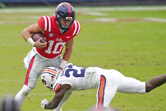 Mississippi quarterback John Rhys Plumlee (10) is tackled by Auburn defensive back Roger McCreary (23) during the second half of an NCAA college football game in Oxford, Miss., Saturday Oct. 24, 2020. Auburn won 35-28. (AP Photo/Rogelio V. Solis)