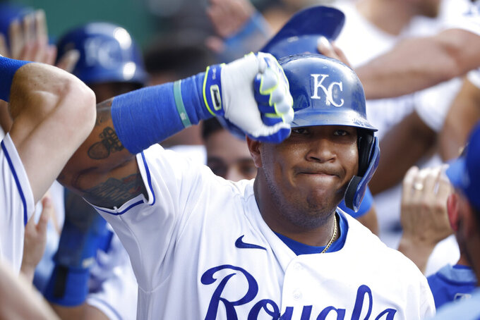Kansas City Royals' Salvador Perez celebrates in the dugout after hitting a three-run home run during the fifth inning of a baseball game against the Detroit Tigers at Kauffman Stadium in Kansas City, Mo., Saturday, July 24, 2021. (AP Photo/Colin E. Braley)