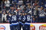 Winnipeg Jets' Kyle Connor (81) celebrates his goal against the Toronto Maple Leafs during second-period NHL hockey game action in Winnipeg, Manitoba, Thursday, Jan. 2, 2020. (John Woods/The Canadian Press via AP)