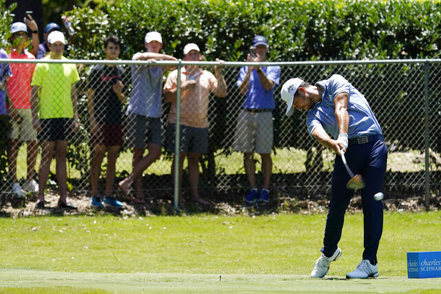 Xander Schauffele tees off on the second hole during the third round of the Charles Schwab Challenge golf tournament at the Colonial Country Club in Fort Worth, Texas, Saturday, June 13, 2020. (AP Photo/David J. Phillip)