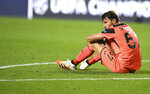 Atalanta's goalkeeper Marco Sportiello reacts after his team's loss in the Champions League quarterfinal match between Atalanta and PSG at Luz stadium, Lisbon, Portugal, Wednesday, Aug. 12, 2020. (David Ramos/Pool Photo via AP)