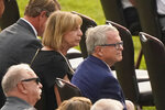 Ohio governor Mike DeWine sits with his wife, Fran, during the funeral for Navy Corpsman Maxton Soviak at Edison High School Stadium, Monday, Sept. 13, 2021, in Milan, Ohio. Soviak was one of 13 U.S. troops killed in a suicide bombing at Afghanistan's Kabul airport on Aug. 26. (AP Photo/Tony Dejak)