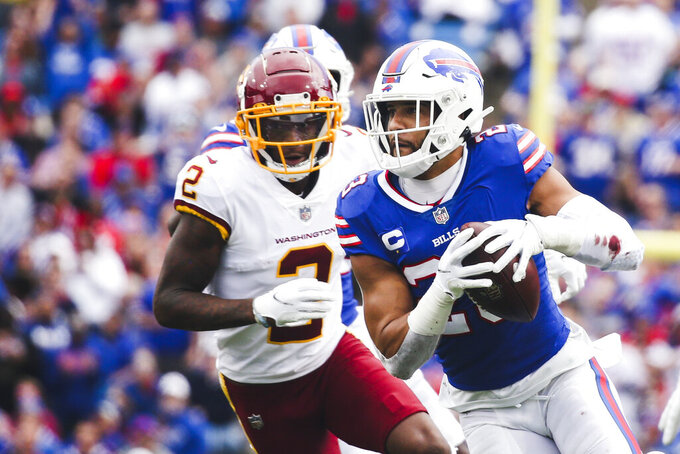 Buffalo Bills' Micah Hyde (23) runs back an interception as Washington Football Team wide receiver Dyami Brown (2) pursues during the second half of an NFL football game Sunday, Sept. 26, 2021, in Orchard Park, N.Y. (AP Photo/Jeffrey T. Barnes)