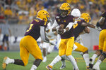Arizona State quarterback Jayden Daniels (5) hands the ball off to running back Eno Benjamin (3) during the first half of the team's NCAA college football game against Kent State, Thursday, Aug. 29, 2019, in Tempe, Ariz. (AP Photo/Ralph Freso)