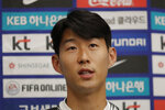 South Korean national soccer team player Son Heung-min answers a reporter's question upon his arrival after the soccer match against North Korea, at Incheon International Airport in Incheon, South Korea, Thursday, Oct. 17, 2019. North Korea held South Korea to a 0-0 draw Tuesday in a World Cup qualifying soccer match played in an empty stadium in Pyongyang, but specific details of the game weren't immediately available. South Korean soccer officials were unable to watch a telecast of the historic game at Kim Il Sung Stadium and South Korean spectators and media were denied entry. (AP Photo/Lee Jin-man)