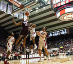 Mississippi State guard Robert Woodard II (12) slams down two between Alabama guard John Petty (23), forward Galin Smith (30) and guard/forward Riley Norris (1) during the first half of an NCAA college basketball game, Tuesday, Jan. 29, 2019, in Tuscaloosa, Ala. (AP Photo/Vasha Hunt)